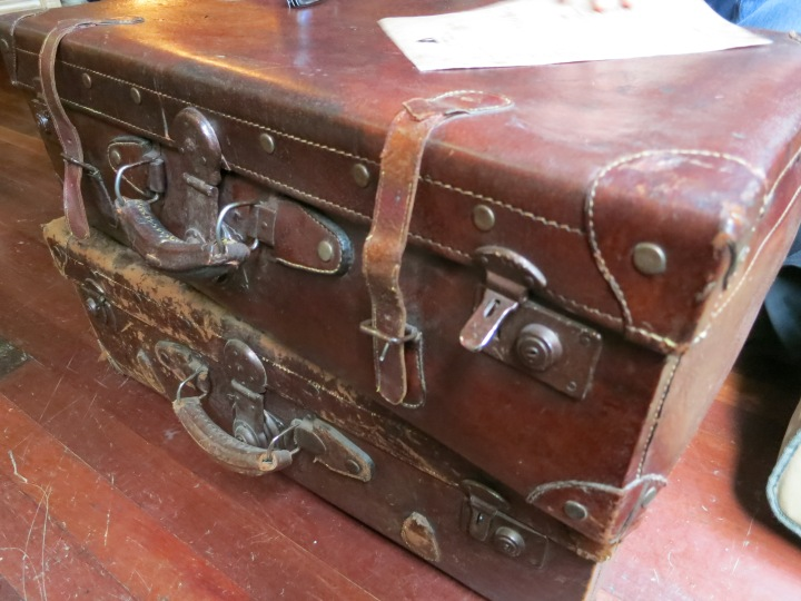 Coffee table made from two old leather suitcases.