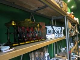 Sherlock Holmes paraphernalia line the shelves.